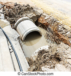 Sewer installation in city - Close up sewer installation in...