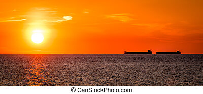 Sunrise on the Chesapeake - Two ships at anchor off of...