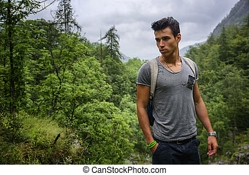 Handsome muscular man backpacking - Handsome muscular young...