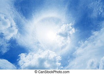 Sun halo or corona phenomenon in cloudy and blue the sky