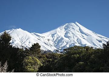 Mount Egmont - Mount Egmont behind bush clad slopes and...