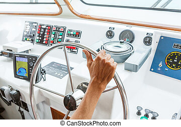 boat steering - Close up captain hand on boat steering wheel