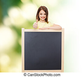 happy little girl with blank blackboard - people,...