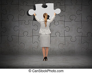 businessman in suit setting piece of puzzle - business,...