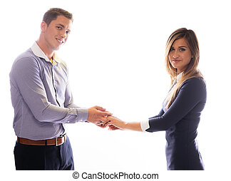 Smiling couple holding each others hands