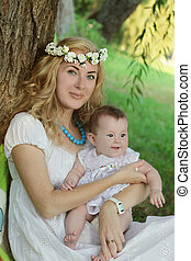 Mother in wreath holding baby girl