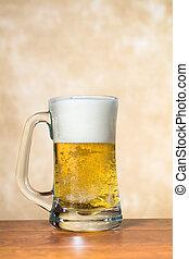 Mug of beer - A beer mug freshly filled with cold, crisp...