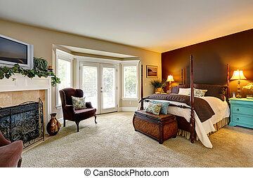 Luxury bedroom with fireplace and walkout deck - Luxury...