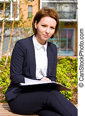 a business woman with clipboard and pen.