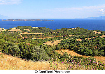 Chalkidiki Greece - Rural farmland and Aegean sea at...