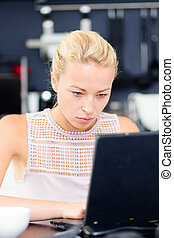 Business woman working from home. - Business woman working...