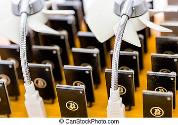 Bitcoin mining - Row of USB bitcoin miners plugged into...
