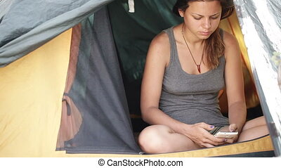 Coffee and smartphone in tent - Beautiful girl opens tent...
