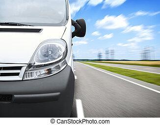 Minivan - The front part of white minivan on the road...