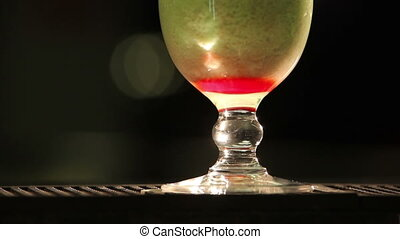 Cocktail panorama - Green cocktail poured into a clear glass