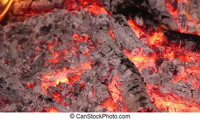 Campfire - close-up logs burning with flames and embers