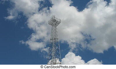 Communication tower with sky and clouds, time lapse