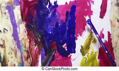 art painting - close-up child painting with gouache at paper
