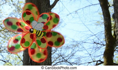 wind toy spin - close of child plastic wind toy with bee...