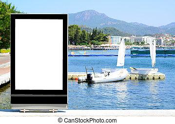 Blank billboard at sea front