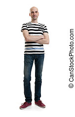 Full length portrait of a stylish young man standing over...