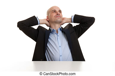 businessman relaxing with hands behind head