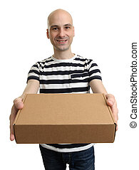 Smiling delivery man holding the box over white background