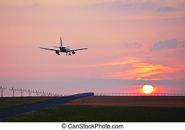 Landing at the sunset - Airplane is landing at the airport