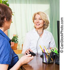 Positive doctor consulting female patient