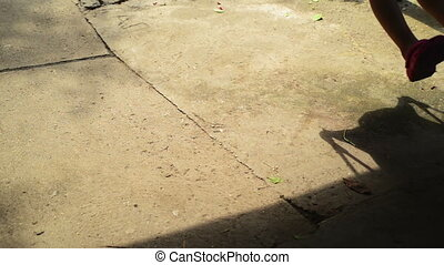 Boy on a swing seat - Shadow of unrecognizable boy child on...