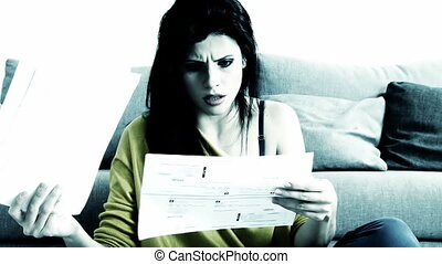 Woman desperate about bills - Sad woman depressed because of...