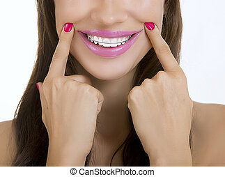 Beautiful smiling girl with retainer on teeth