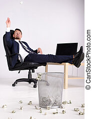 Money - Rich businessman having fun in his office. Just...