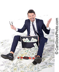Money - I am rich! Happy young businessman in formalwear...