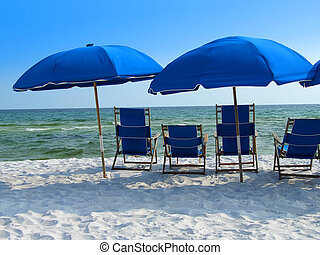Blue beach umbrellas and chairs in Florida