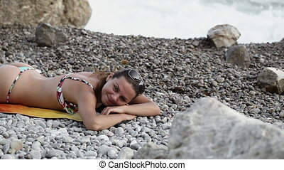 Woman herding wave - Woman resting herding from shore wave