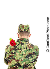 Back of a soldier with red rose over shoulder - Back of a...