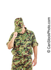 soldier with hidden face in green camouflage uniform covers...