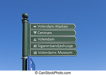 green signpost - signpost with some touristic highlights of...