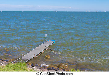 small pier - old decayed pier at the Markermeer in the...