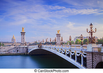 The Grand Palais and Pont Alexandre III Bridge at cloudy day
