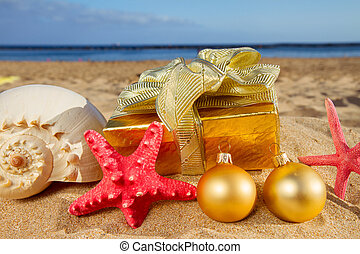 christmas gifts on beach - christmas gifts with shells and...