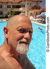 An englishman on vacation with a pool in background