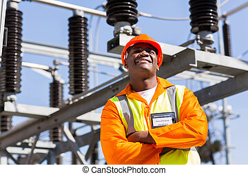 african electrical engineer with arms crossed in electricity...
