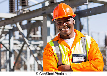 substation worker - african electrical worker in electric...