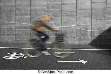 cyclist in blurred motion - Cyclist in blurred motion on...