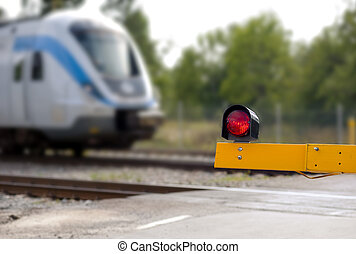 Railroad crossing with commuter train in blurred motion