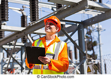 middle aged electrical engineer with clipboard - happy...