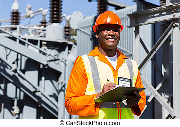 young african technician working in substation - young...