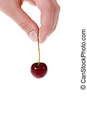 red cherry in hand